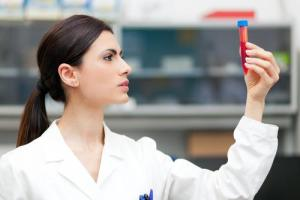 woman-researcher-doing-blood-test-laboratory